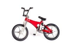 Ny röd cykel Royaltyfria Foton