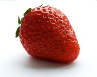 Ny röd en jordgubbe som isoleras på vit bakgrund, nya frukter, sommarbär, rött bär, jordgubbe Royaltyfri Bild