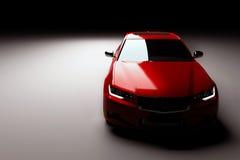 Ny röd metallisk sedanbil i strålkastare Modern desing som är brandless Arkivfoto
