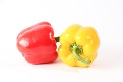 Ny röd och gul paprika Arkivbild