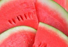 Ny röd vattenmelon skivad bakgrund Fotografering för Bildbyråer