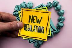 Ny reglemente för handskrifttext Begreppsbetydelseändring av lagar härskar företags normala specifikationer som är skriftliga på  Royaltyfri Fotografi
