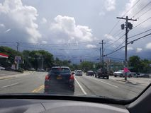 Storm clouds beyond the traffic. NY road on a hot, humid and soon to be stormy summer day royalty free stock images