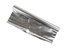 Ny rulle av aluminum folie på en vit bakgrund. Fotografering för Bildbyråer