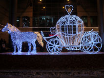 New Years cinderella carriage and horse. Festive light-bright queen carriage and horse Royalty Free Stock Photo