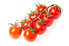 Ny saftig röd gruppcloseup för körsbärsröd tomat som isoleras på vit bakgrund Royaltyfria Foton