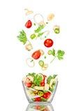 ny sallad Blandade fallande grönsaker Arkivfoton