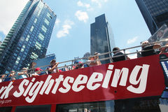 NY sightseeing bus tour. Tourists on a sightseeing bus tour with Royalty Free Stock Photo