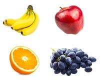 Ny skivad orange frukt, filial av blåa druvor Arkivfoto