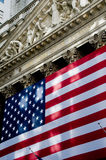 NY Stock Exchange. The New York Stock Exchange with the American flag Royalty Free Stock Photo