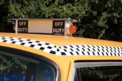 NY Teken het Buiten dienst van de Taxi stock foto