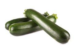 Ny zucchini på vit bakgrund Royaltyfria Foton