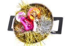 , Nya År-bollar, glitter i kastrull Arkivfoton