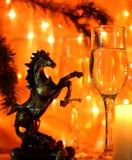 Nya år helgdagsaftonberömbakgrund med hästen Royaltyfria Bilder