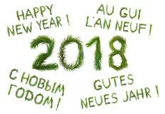 2018 nya år Tvåtusen arton Ð-¡ ongratulationen uttrycker det lyckliga nya året som är på engelska som är ryskt, franska och tysk Arkivfoton