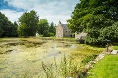 Nya Abbey Mill Pond, Dumfriesshire, Skottland Arkivbild