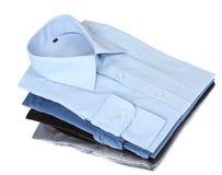 Nya blått- och grå färgman skjortor Arkivfoto