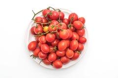 Nya Cherrytomater på vit bakgrund Fotografering för Bildbyråer