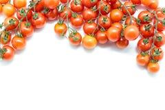 Nya Cherrytomater på vit bakgrund Bästa sikt med kopieringsutrymme Fotografering för Bildbyråer