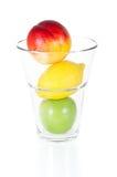 Nya frukter i exponeringsglas som isoleras på vit Fotografering för Bildbyråer