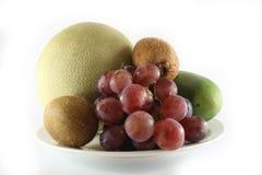 Nya frukter & platta Arkivbild
