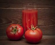 nya fulla glass fruktsafttomattomater Fotografering för Bildbyråer