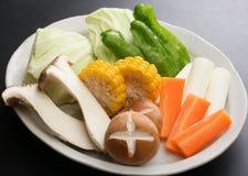 Nya grönsaker för varm kruka med havre, champinjon, morot, rädisa Arkivbild