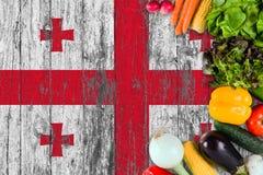 Nya grönsaker från Georgia på tabellen Laga mat begrepp p? tr?flaggabakgrund royaltyfri foto