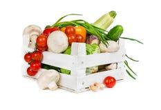 Nya grönsaker i ask Royaltyfri Bild