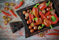 Nya grönsaker - organisk peppar, paprika och körsbär Fotografering för Bildbyråer