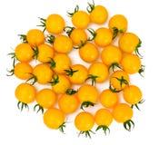 Nya gula Cherry Tomato på Whyite bakgrund royaltyfria foton