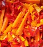 Nya högg av morötter och peppar Fotografering för Bildbyråer