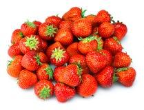 Nya jordgubbar på vit bakgrund Arkivfoto