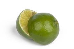 Nya limefrukter på vit Arkivbilder