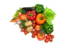 Nya mogna grönsaker på vit bakgrund Arkivfoton
