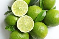 Nya mogna limefrukter på vit bakgrund Fotografering för Bildbyråer