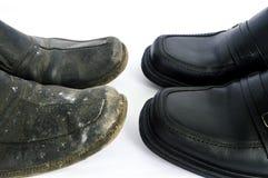 Nya och använda skor Fotografering för Bildbyråer