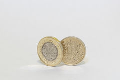 Nya och gamla ett pund mynt Royaltyfri Fotografi