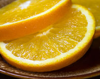 nya orange skivor Arkivfoton