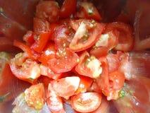 nya skivade tomater Arkivbild