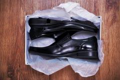 nya skor Arkivfoto