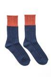 Nya sockor som isoleras på vit Arkivfoton