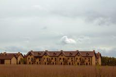 Nya tegelstenradhus Fotografering för Bildbyråer