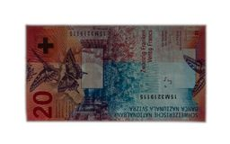 Nya tjugo schweizisk franc genomskinlig isolerad vit bakgrund arkivfoto