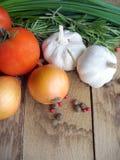 nya tomater för vitlökörtlök Arkivbilder