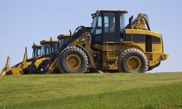 nya traktorer för konstruktion royaltyfria bilder
