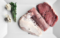 Nya tre typer av kött på plattan Royaltyfria Foton