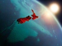 Nya Zeeland från utrymme under soluppgång Royaltyfri Bild