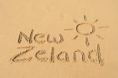 Nya Zeland i sanden Arkivfoto