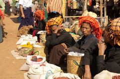 NYAUNG SHWE, MYANMAR - Friday Market. NYAUNG SHWE, MYANMAR - OCT 15:  Ethnic Minorities sell fresh products at  friday market on Oct 15,2010 in in Nyaung Shwe Stock Photos
